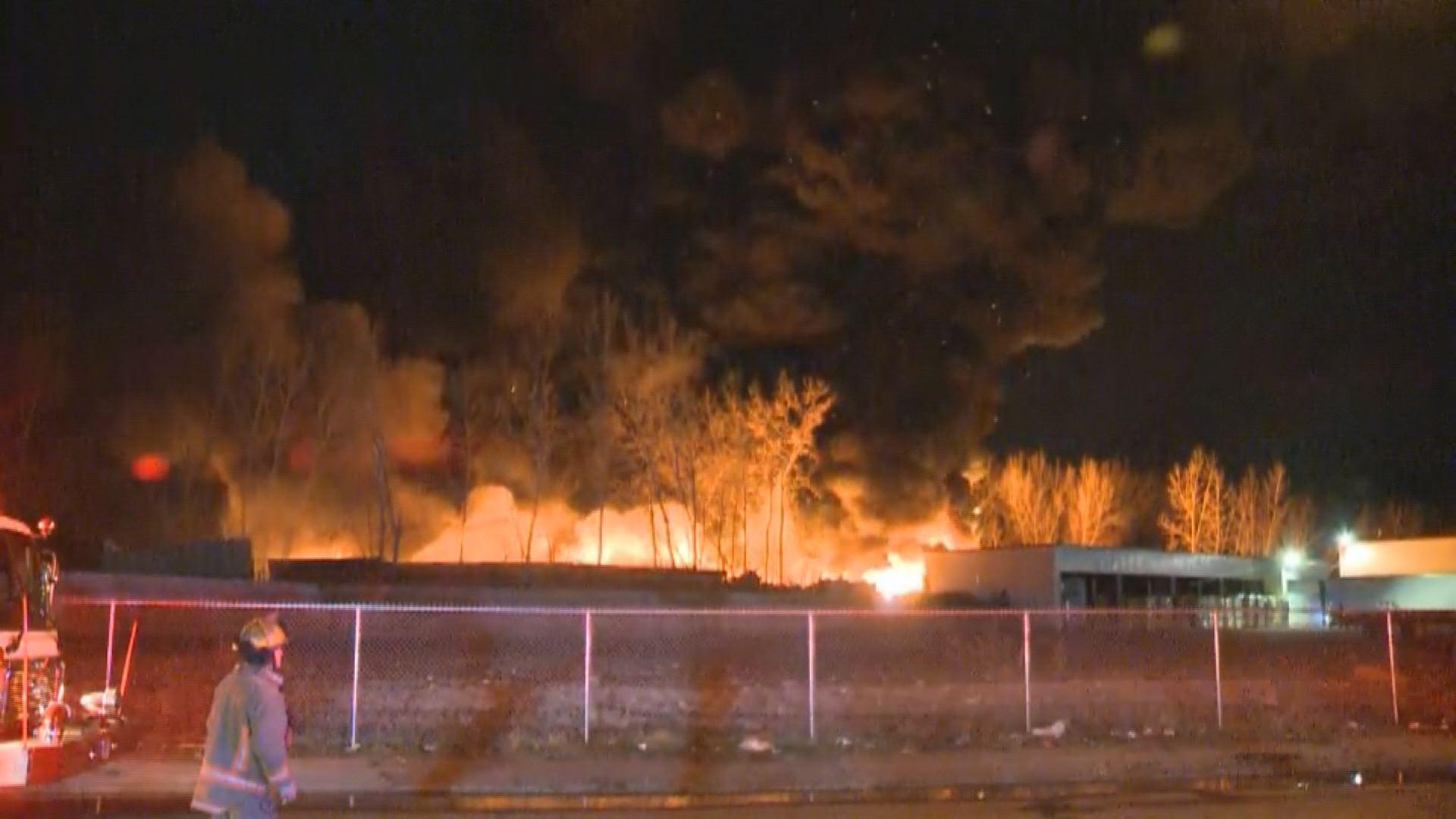 Large junkyard fire near chemical warehouse   WGRZ.com